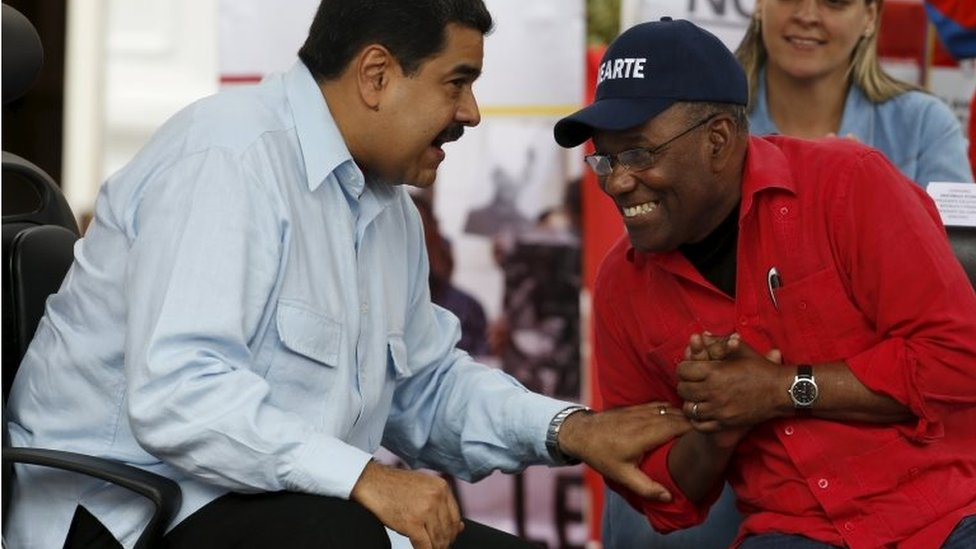 President Nicolas Maduro (L) speaks with Venezuela's Vice President Aristobulo Isturiz during a rally against the opposition's amnesty law at Miraflores Palace in Caracas April 7, 2016.