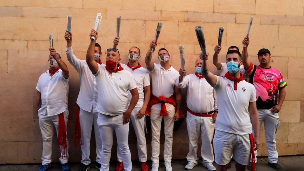 The traditional running of the bulls was cancelled but these traditional singers turned up for the first day