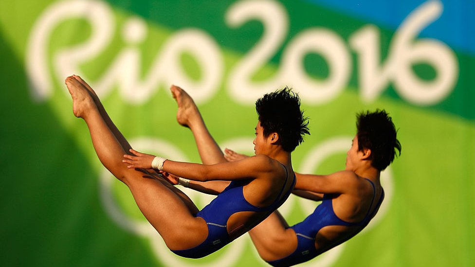 Kuk Hyang Kim and Mi Rae Kim of Democratic People's Republic of Korea compete in the Women's Diving Synchronised