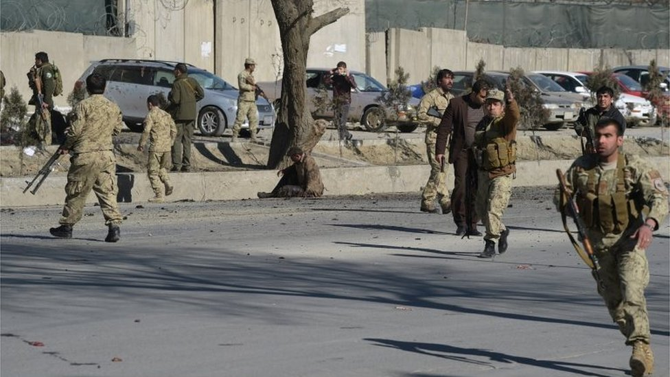 Afghan security personnel gather at the site of a suicide car bomb next to a police base in Kabul on 1 February 2016