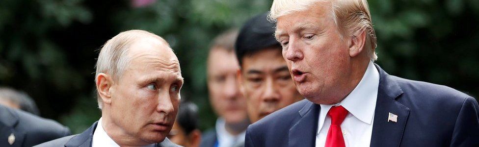 US President Donald Trump and Russia's President Vladimir Putin talk at the APEC Summit in Danang