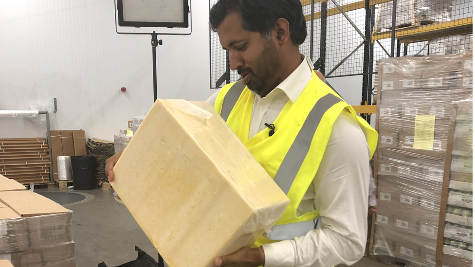 Block of cheddar at Combe Castle dairy