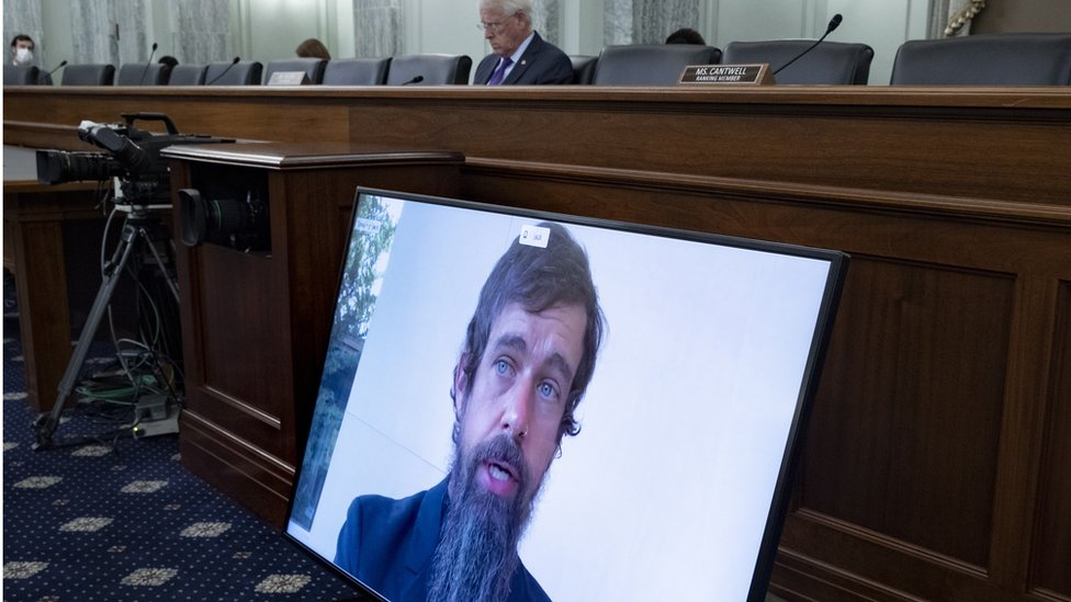 CEO of Twitter Jack Dorsey appears on a monitor as Chairman of the Senate Commerce, Science, and Transportation Committee Roger Wicker (Back) listens