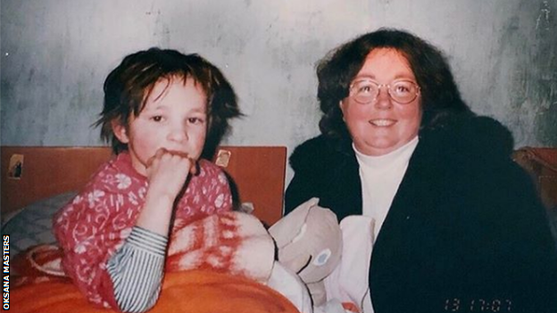 Oksana Masters as a child, with her adoptive mother