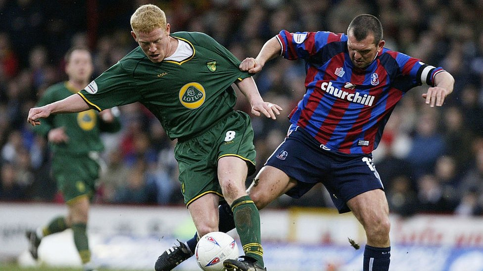 Neil Shipperley of Crystal Palace tries to tackle Gary Holt of Norwich City during the Nationwide Division One