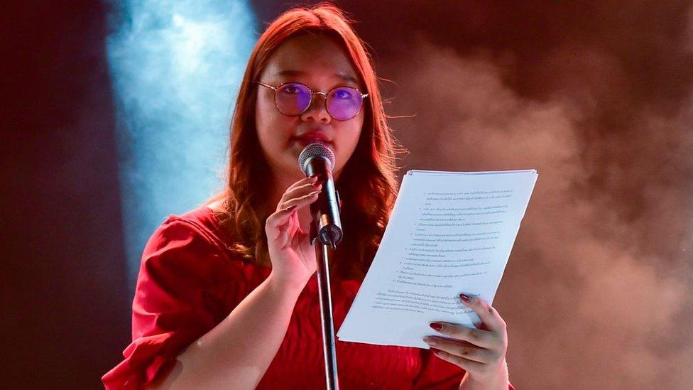Student Union of Thailand spokesperson Panusaya Sithijirawattanakul reads a list of demands on August 10, 2020