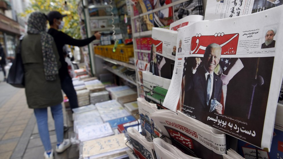 "A copy of Iranian daily newspaper Shargh, with a picture of US president-elect Joe Biden and headline ""No to populism"", on display at a kiosk in Tehran, Iran (8 November 2020)"