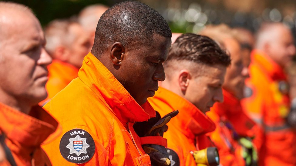 Emergency services marked the minute's silence in the capital