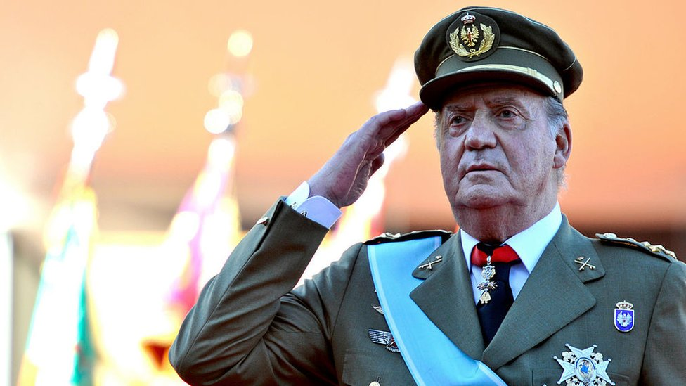 King Juan Carlos in military uniform saluting