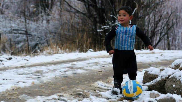 Murtaza Ahmadi, five, wears a plastic bag jersey as he plays football in Jaghori district of Ghazni province