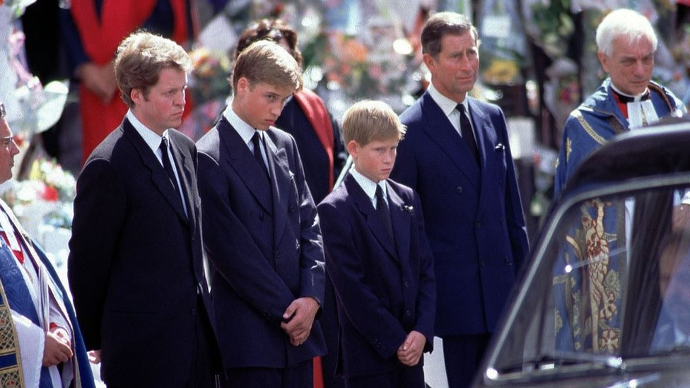 L-R Earl Spencer Charles, Prince William, Prince Harry and Prince Charles stand alongside the hearse containing the coffin of Diana after the funeral service at Westminster Abbey