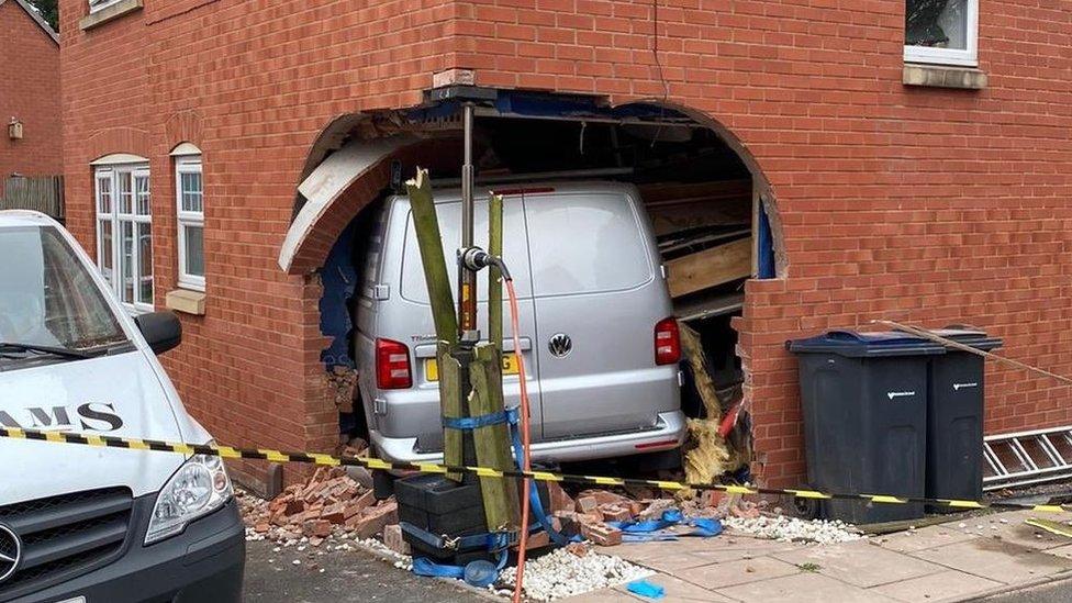 Van inside the property following the crash