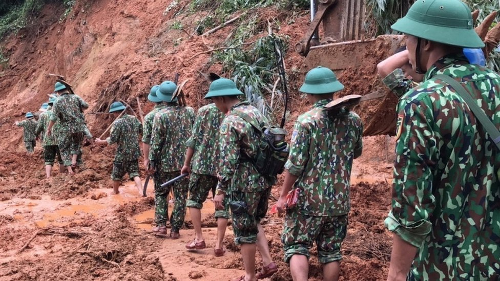 Vietnam landslide: Rescuers search for survivors at barracks thumbnail