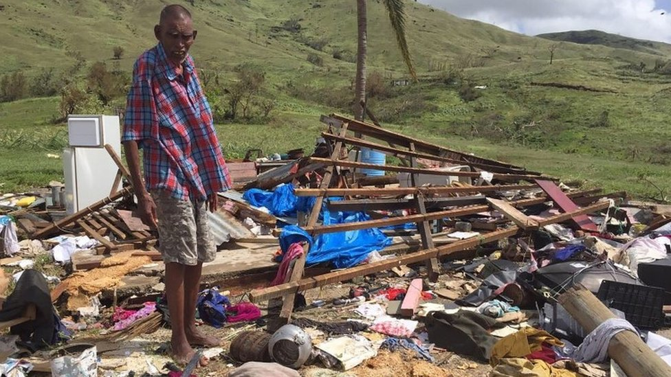 A man stands over the ruins of his house following Cyclone Winston in western Fiji (22 February 2016)