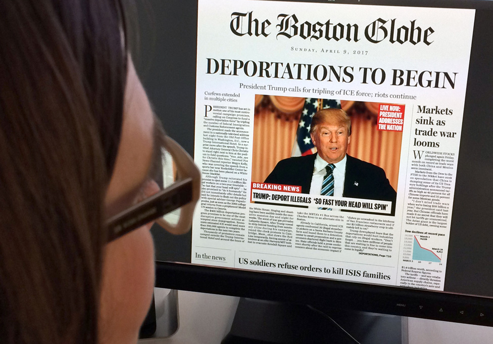 Woman reads mock-up of what a front page might look like should Republican frontrunner Donald Trump win the presidency