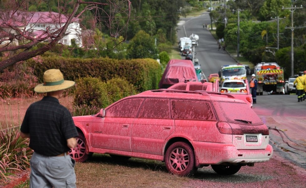 A car sprayed with fire retardant is seen after a bushfire in the residential area of Sydney on November 12, 2019