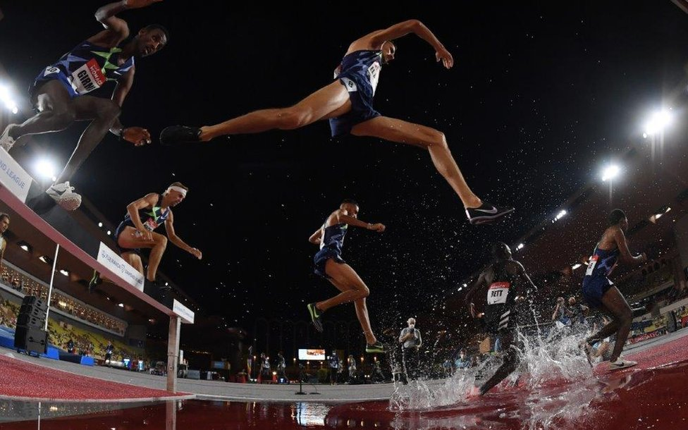 Morocco's Soufiane EL Bakkali (C) competes in the men's 3000metre steeplechase event during the Diamond League Athletics Meeting at The Louis II Stadium in Monaco on August 14, 2020.