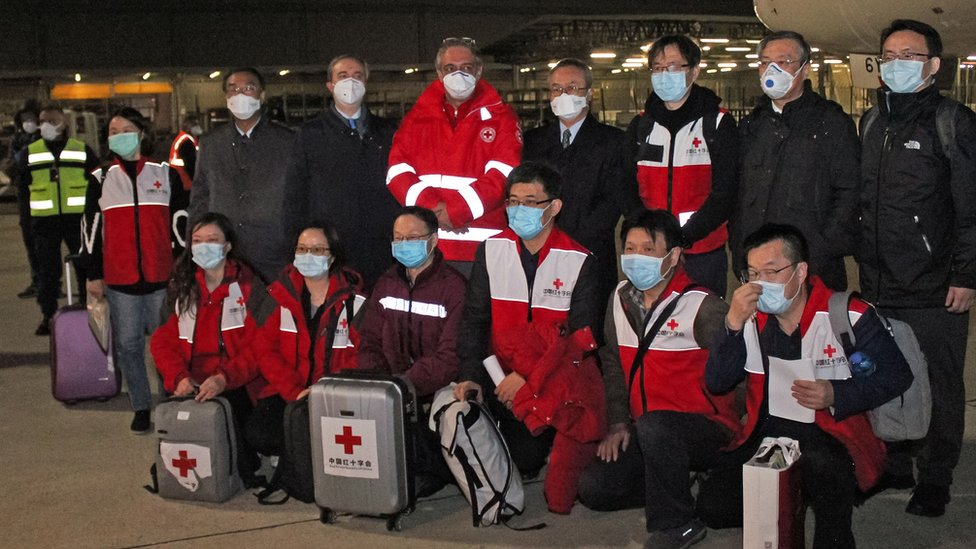 Chinese medics posing for a group photo after landing on a China Eastern flight on March 13 at Rome