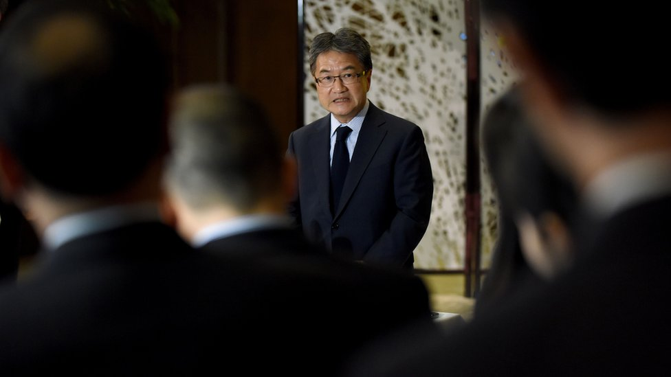 Joseph Yun (C), US special representative for North Korea policy, answers questions from reporters following a meeting with Japanese and South Korean chief nuclear negotiators at the Iikura Guesthouse in Tokyo on 27 April 2017.