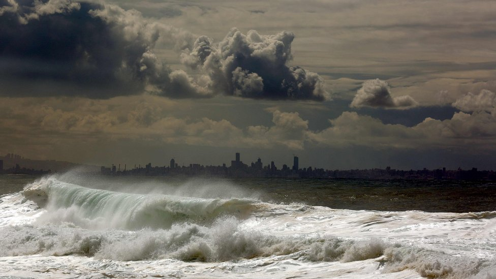 Waves hit the port of Byblos, with the Lebanese capital Beirut in the background (22 February 2016)