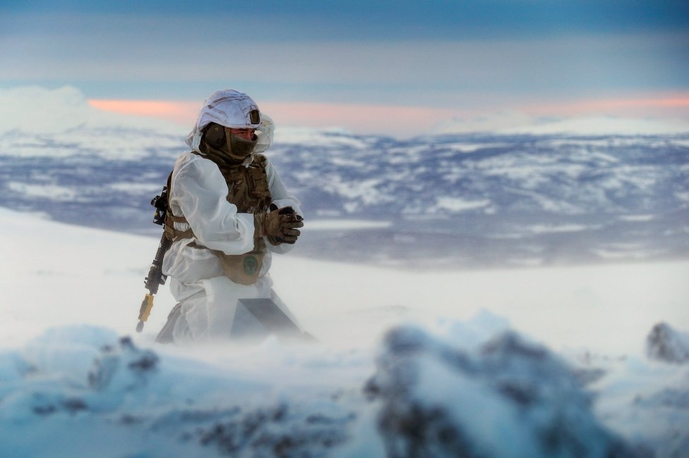 A Royal Marine works in the Arctic Circle