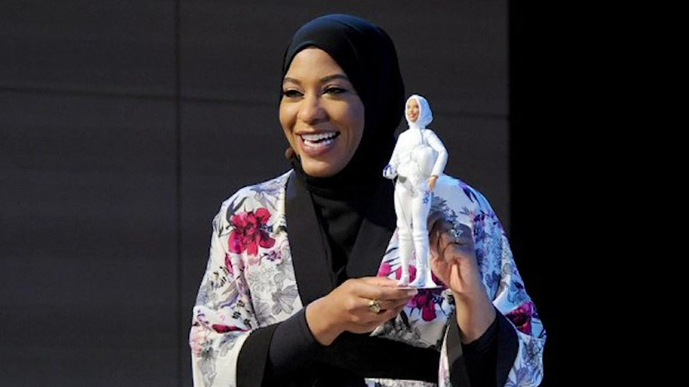 Ibtihaj Muhammad with the Barbie doll that is modelled on her