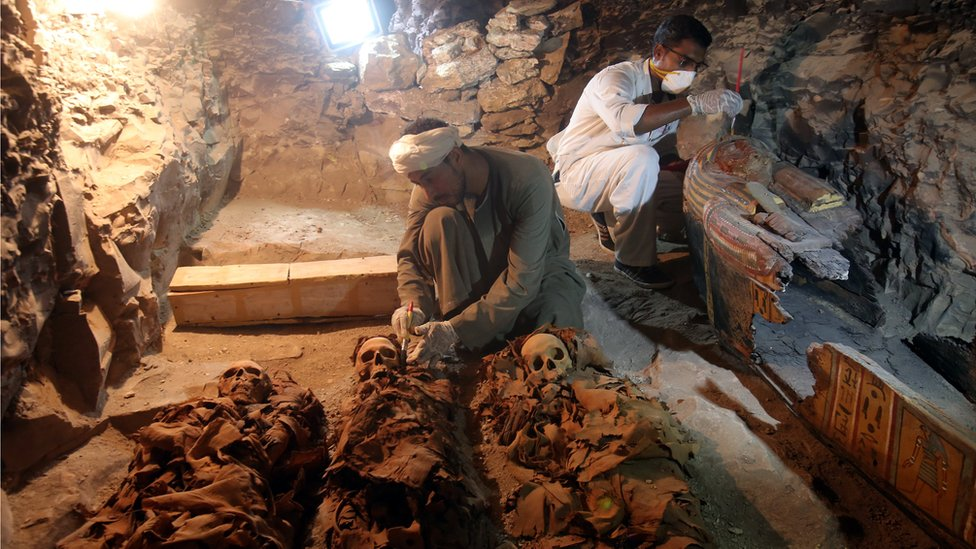 Egyptian archaeologists work on mummies at a recently discovered tomb in the Draa Abul Nagaa necropolis, Luxor's West Bank, 700km south of Cairo, Egypt, 9 September 2017