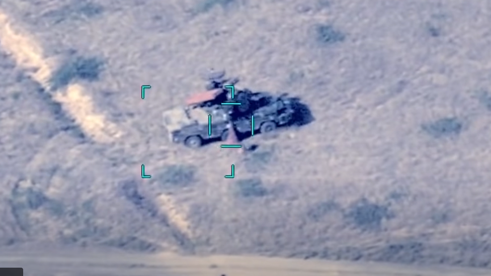 A drone targeting an Osa (or Wasp) anti-aircraft system.