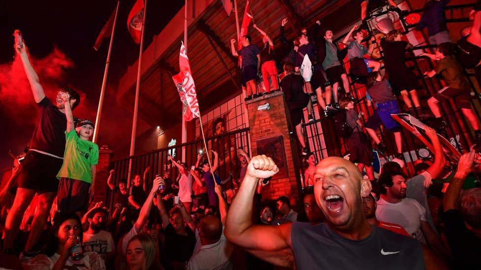 Fans celebrate Liverpool becoming Premier League Champions outside Anfield