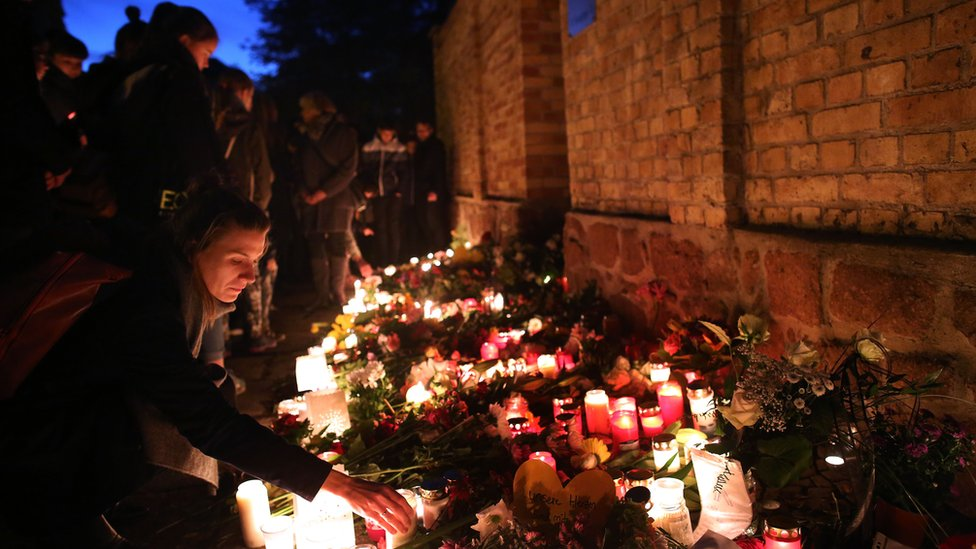 Mourners light candles at the synagogue in Halle and der Saale, eastern Germany, on October 10, 2019 one day after the deadly anti-Semitic shooting.