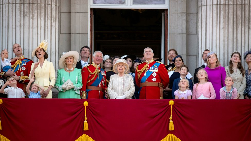 The Royal Family on the balcony at Buckingham Palace looking up at a flypast