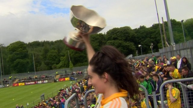 Antrim captain Una McNaughton holds the Ulster Camogie trophy aloft after her team's 3-7 to 2-9 win over holders Derry in the provincial final at Ballybofey
