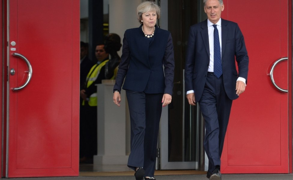 Prime Minister Theresa May and Chancellor of the Exchequer Philip Hammond at Heathrow
