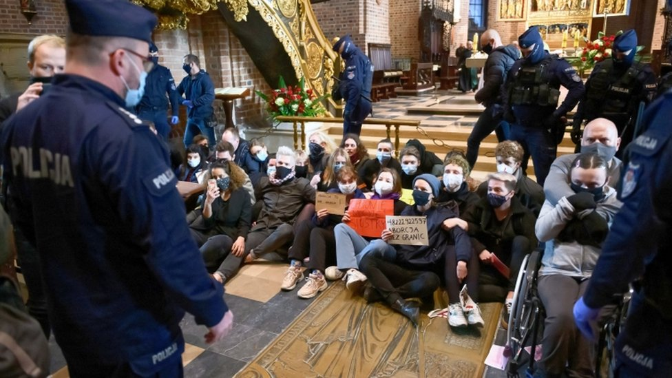 Protesters stage a sit-in at the Archcathedral Basilica of St Peter and St Paul in Poznan, Poland