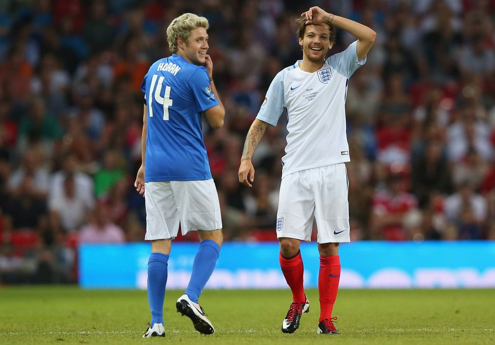 Niall Horan and Louis Tomlinson playing in Soccer Aid in 2016.