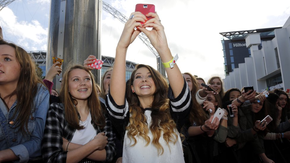 Zoella posing for a selfie on the red carpet at the BBC Radio 1 Teen Awards, 2014