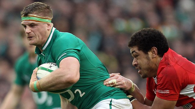 Taulupe Faletau tackles Jamie Heaslip during the 2012 Six Nations contest