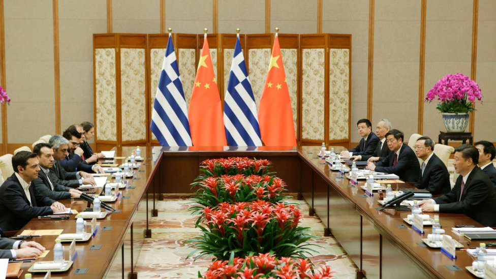 Greece's Prime Minister Alexis Tsipras (L) talks with China's President Xi Jinping (R), ahead of the Belt and Road Forum, in Beijing on May 13, 2017