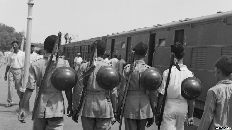 Muslim League National Guards on a platform at a railway station in New Delhi, India, August 1947. They are helping with the departure of six hundred Muslim residents of Delhi to Karachi, Pakistan on a special train