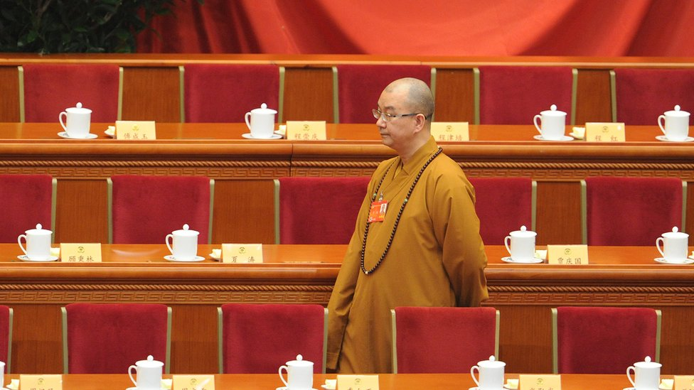 Buddhist Master Xuecheng arrives at the opening session of the Chinese People's Political Consultative Conference , 2014