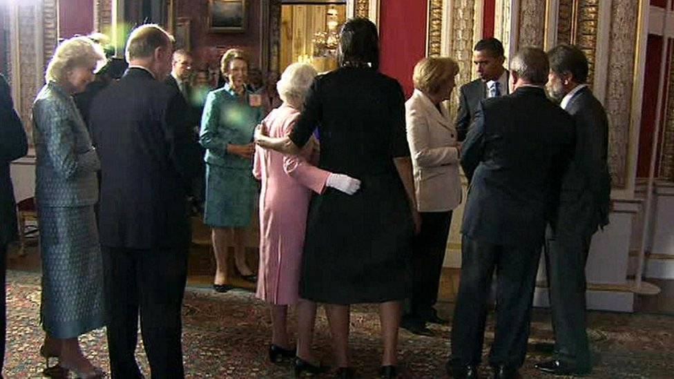 The Queen and Michelle Obama place their arms around each other at Buckingham Palace reception in 2009