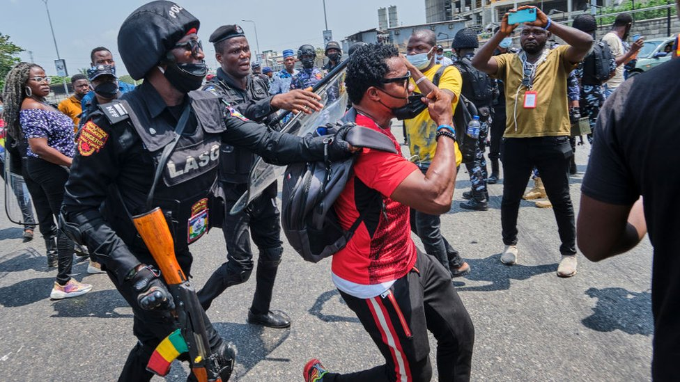 A policeman arresting a protestor during a demonstration against the re-opening of the Lekki toll plaza in Lagos.