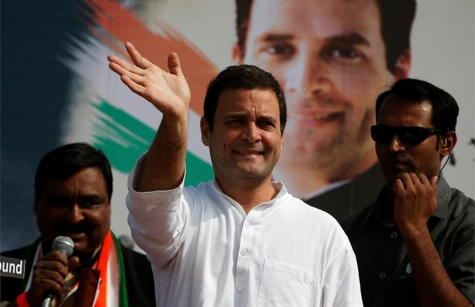 Rahul Gandhi of the main opposition Congress Party waves to his supporters during a rally ahead of Gujarat state assembly elections, at a village on the outskirts of Ahmedabad, India November 11, 2017