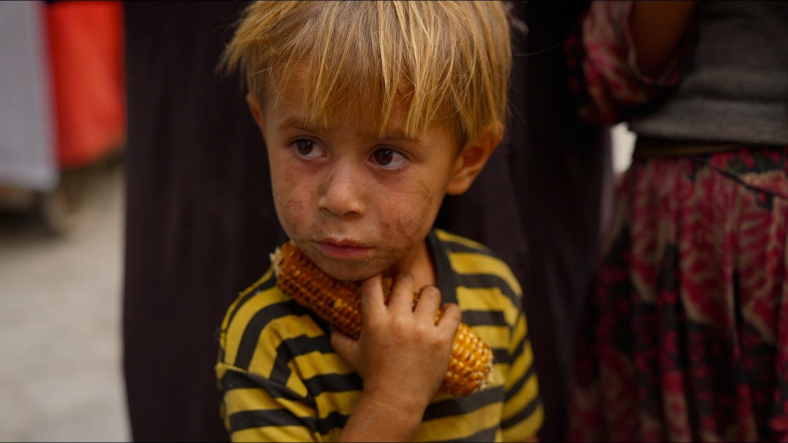 Kabul child with corn