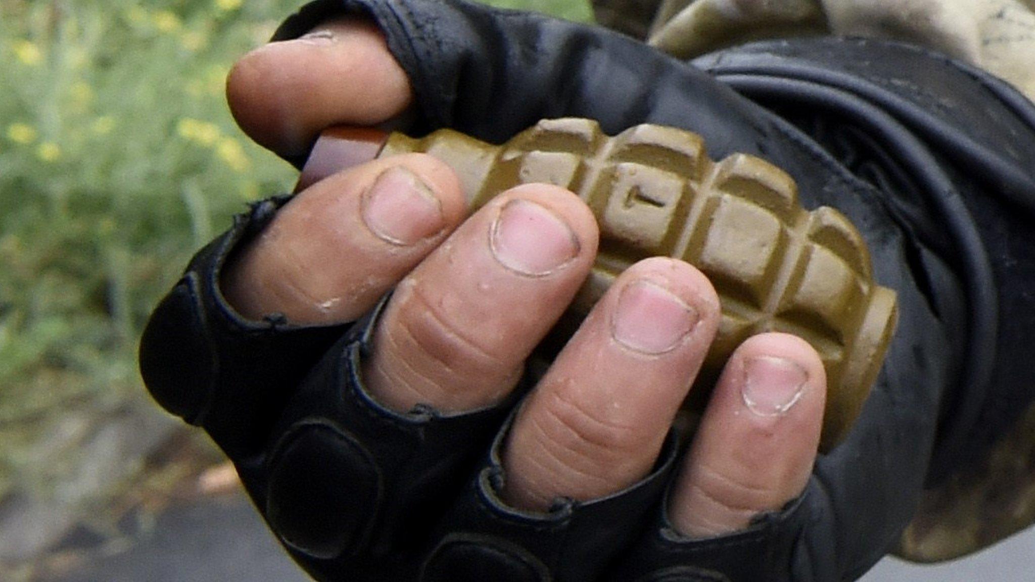 Ukraine 'father of deceased' sets off courtroom grenades
