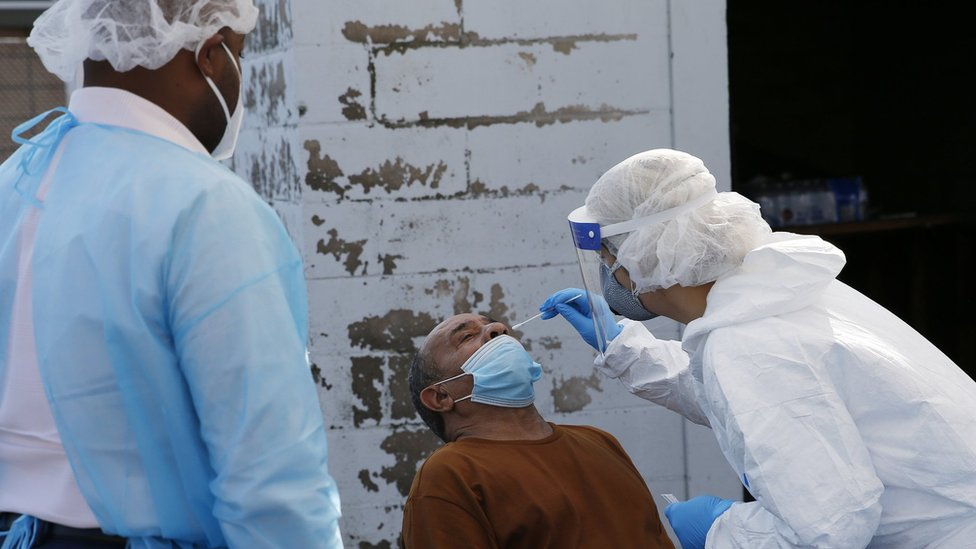 A nurse a coronavirus test at a COVID-19 testing site in Boston on Oct. 22, 2020.