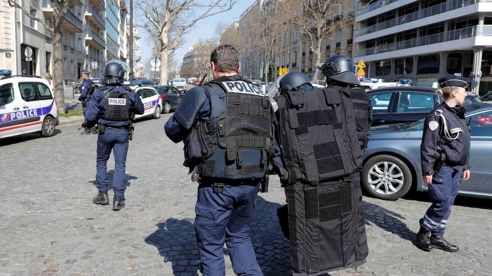 Police outside the International Monetary Fund (IMF) offices where an envelope exploded in Paris, France, 16 March