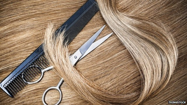 A generic image of hair, scissors and a comb