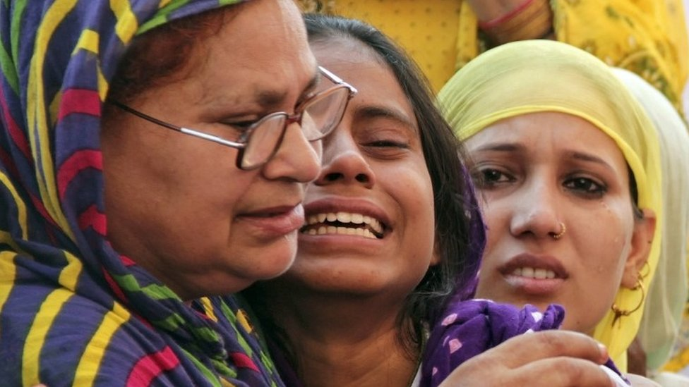 Relatives of Mohammad Akhlaq mourn after he was killed by a mob on Monday night, at his residence in Dadri town, in the northern state of Uttar Pradesh, India, September 29, 2015.