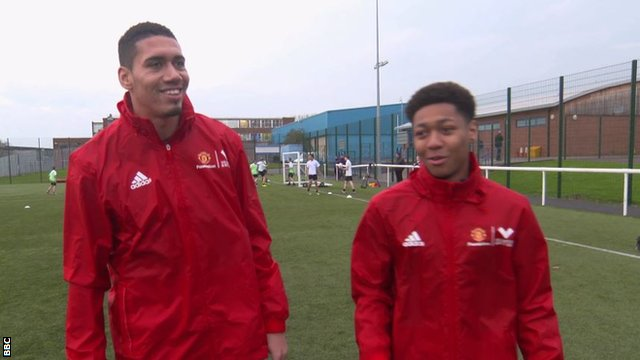 Chris Smalling and a young volunteer